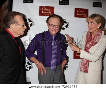 LOS ANGELES - MAR 25:  Larry King, Larry King Wax figure (Purple shirt) and Shawn Southwick King at the Charlie Awards at Hollywood Roosevelt Hotel on March 25, 2011 in Los Angeles, CA - stock photo