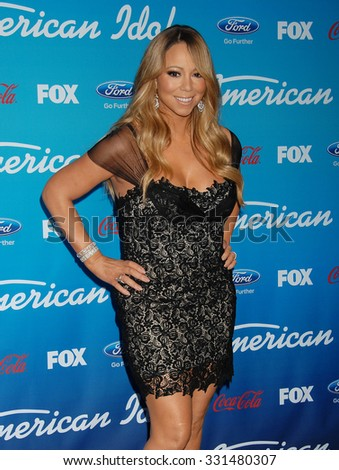 LOS ANGELES - MAR 7 - Mariah Carey arrives at the American Idol Season 12 Finalists Party on March 7, 2013 in Los Angeles, CA              - stock photo