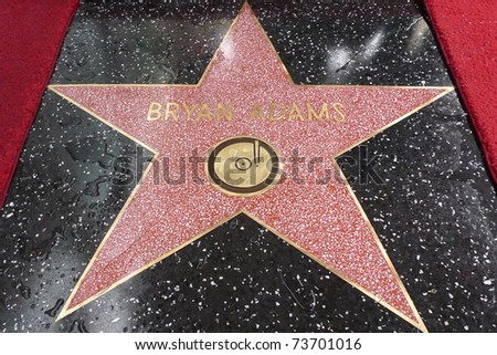 LOS ANGELES - MAR 21: Singer Bryan Adams at a ceremony where he is honored with a star on the Hollywood Walk of Fame in Los Angeles, California on March 21, 2011. - stock photo