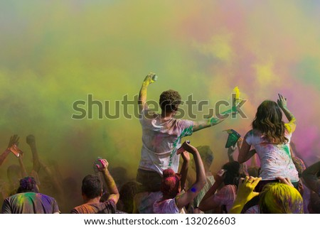 LOS ANGELES - MARCH 16 : Dancing and celebrating during the color throw. Holi Festival of Colors on March 16, 2013 in Los Angeles, CA - stock photo