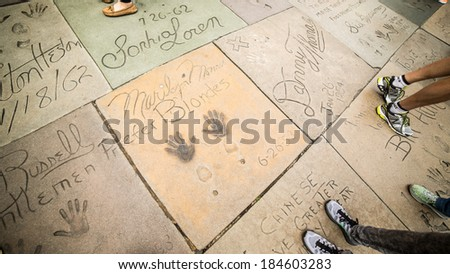 LOS ANGELES - MARCH 29: Marilyn Monroe inscription outside the Chinese Theater on March 29, 2014 in Hollywood. TCL Chinese Theatre is a cinema on the Hollywood Walk of Fame in Los Angeles. - stock photo