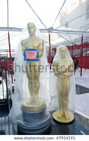 LOS ANGELES - MARCH 3:  Oscar statues waiting to be moved in front of the Kodak Theater on March 3, 2010 in Los Angeles.  The 82nd annual Academy Awards will be held on March 7 - stock photo