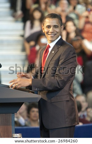 LOS ANGELES - MARCH 19: President Barack Obama ready to speak at a town hall meeting at the Miguel Contreras Learning Center on March 19th, 2009 in Los Angeles. - stock photo