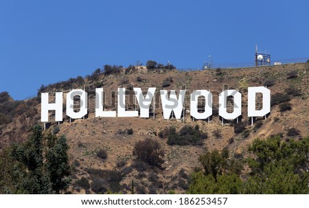 LOS ANGELES - MARCH 17: The Hollywood Sign located in the Hollywood Hills section of Los Angeles on March 17, 2014. Built in 1923, The Hollywood Sign is a world famous landmark symbolizing Hollywood. - stock photo