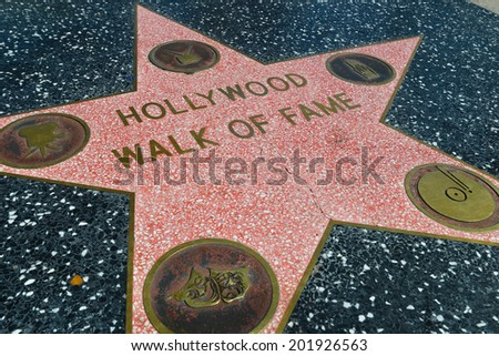 LOS ANGELES-MARCH 1:Walk of fame star on the Hollywood Walk of Fame on March 1, 2014 in Los Angeles. Stars on the Walk of Fame draw tourists from all over the world. - stock photo