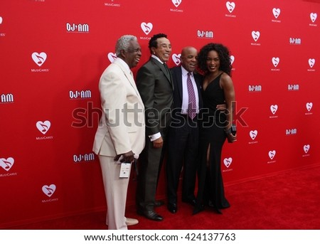 LOS ANGELES - MAY 19, 2016: Angela Bassett,Berry Gordy,Smokey Robinson & Mickey Stevenson on the red carpet of the 12th Annual MusiCares Map Fund Benefit Concert Honoring Smokey Robinson at The Novo - stock photo
