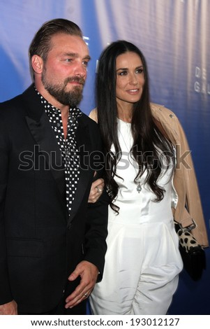 LOS ANGELES - MAY 15:  Brian Bowen Smith, Demi Moore at the De Re Gallery Opening at De Re Gallery on May 15, 2014 in West Hollywood, CA - stock photo