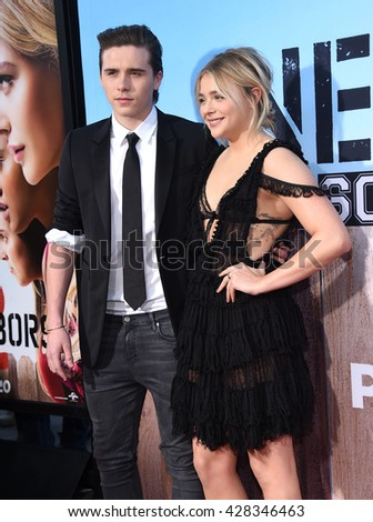 "LOS ANGELES - MAY 16:  Brooklyn Beckham & Chloe Grace Moretz arrives to the ""Neighbors 2: Sorority Rising"" Los Angeles Premiere  on May 16, 2016 in Hollywood, CA.                 - stock photo"