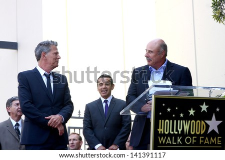 LOS ANGELES - MAY 31:  David Foster, Dr. Phil McGraw at the David Foster Hollywood Walk of Fame Star Ceremony at the Capital Records Building on May 31, 2013 in Los Angeles, CA - stock photo