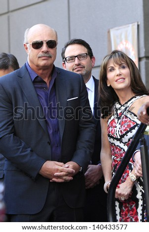 LOS ANGELES - MAY 13: Dr Phil McGraw, Robin McGraw at a ceremony where Steve Harvey is honored with a star on the Hollywood Walk Of Fame on May 13, 2013 in Los Angeles, California - stock photo