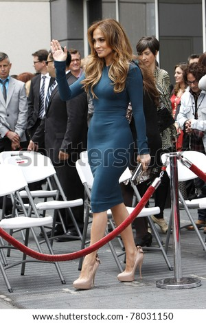 LOS ANGELES - MAY 23: Jennifer Lopez at a ceremony where Simon Fuller receives a star on the Hollywood Walk of Fame in Los Angeles, California on May 23, 2011. - stock photo