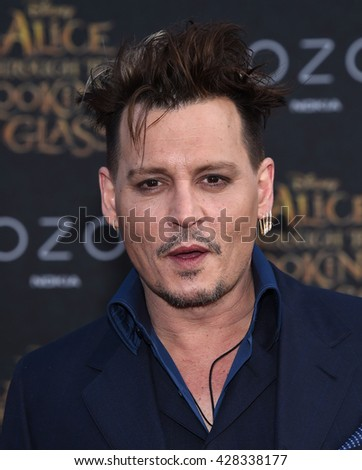 """LOS ANGELES - MAY 23:  Johnny Depp arrives to the """"Alice Through The Looking Glass"""" American Premiere  on May 23, 2016 in Hollywood, CA.                 - stock photo"""