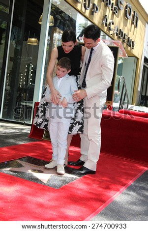 LOS ANGELES - MAY 1: Julianna Margulies, Kieran Lieberthal, Keith Lieberthal at the Julianna Margulies Hollywood Walk of Fame Star Ceremony at the Hollywood Boulevard on May 1, 2015 in Los Angeles, CA - stock photo