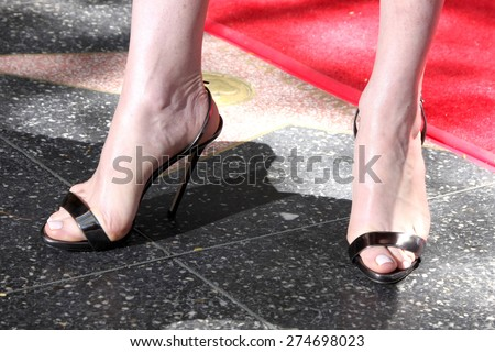 LOS ANGELES - MAY 1:  Julianna Margulies (shoe detail) at the Julianna Margulies Hollywood Walk of Fame Star Ceremony at the Hollywood Boulevard on May 1, 2015 in Los Angeles, CA - stock photo