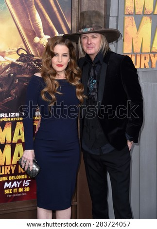 """LOS ANGELES - MAY 07:  Lisa Marie Presley & Michael Lockwood arrives to the """"Mad Max: Fury Road"""" Los Angeles Premiere  on May 7, 2015 in Hollywood, CA                 - stock photo"""