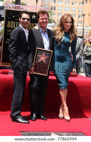 LOS ANGELES - MAY 23:  Marc Anthony, Simon Fuller, Jennifer Lopez at the Simon Fuller Hollywood Walk Of Fame Star Ceremony at W Hotel - Hollywood on May 23, 2011 in Los Angeles, CA - stock photo