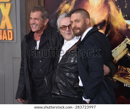 """LOS ANGELES - MAY 07:  Mel Gibson, Tom Hardy & George Miller arrives to the """"Mad Max: Fury Road"""" Los Angeles Premiere  on May 7, 2015 in Hollywood, CA                 - stock photo"""