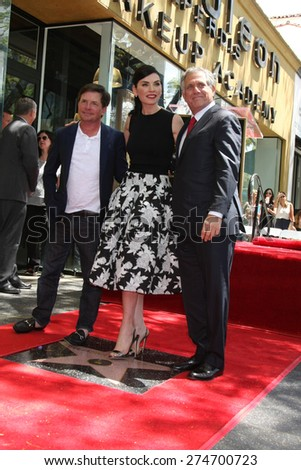 LOS ANGELES - MAY 1:  Michael J. Fox, Julianna Margulies, Les Moonves at the Julianna Margulies Hollywood Walk of Fame Star Ceremony at the Hollywood Boulevard on May 1, 2015 in Los Angeles, CA - stock photo