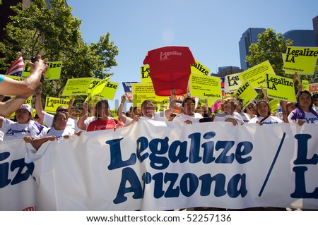 LOS ANGELES - MAY 1: On International Workers' Day, people march in Downtown on support to Arizona immigrants, gay rights and demand an immigration reform on May 1, 2010 in Los Angeles. - stock photo