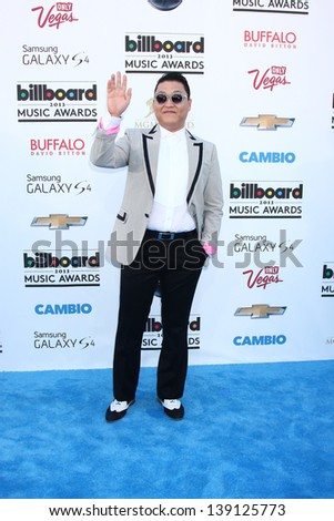 LOS ANGELES -  MAY 19:  Psy arrives at the Billboard Music Awards 2013 at the MGM Grand Garden Arena on May 19, 2013 in Las Vegas, NV - stock photo