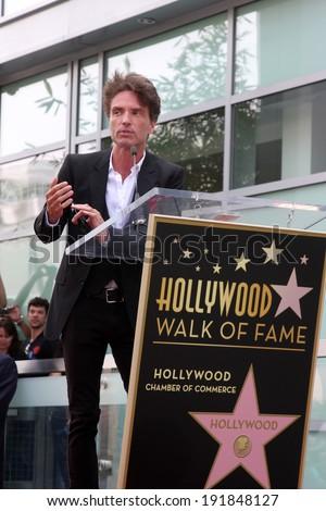 LOS ANGELES - MAY 9:  Richard Marx at the Rick Springfield Hollywood Walk of Fame Star Ceremony at Hollywood Blvd on May 9, 2014 in Los Angeles, CA - stock photo