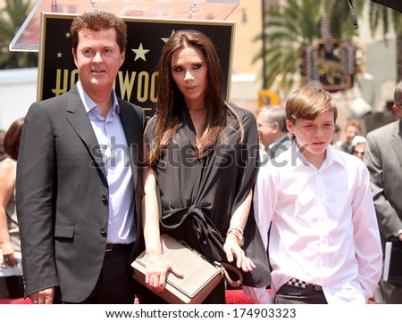 LOS ANGELES - MAY 23:  Simon Fuller, Victoria Beckham & son Brooklyn arrives to the Walk of Fame Ceremony for Simon Fuller  on May 23, 2011 in Hollywood, CA                 - stock photo