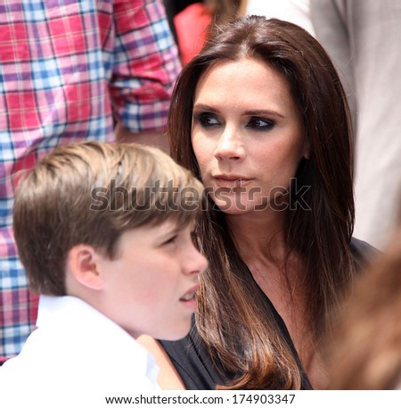 LOS ANGELES - MAY 23:  Victoria Beckham & son Brooklyn arrives to the Walk of Fame Ceremony for Simon Fuller  on May 23, 2011 in Hollywood, CA                 - stock photo
