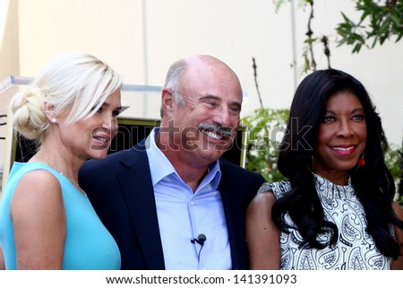 LOS ANGELES - MAY 31:  Yolanda Foster, Dr Phil McGraw, Natalie Cole at the David Foster Hollywood Walk of Fame Star Ceremony at the Capital Records Building on May 31, 2013 in Los Angeles, CA - stock photo