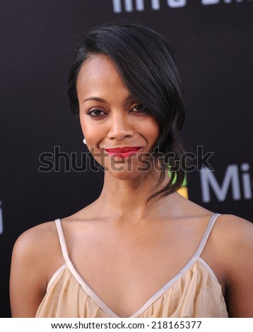 """LOS ANGELES - MAY 14:  Zoe Saldana arrives to the """"Star Trek Into Darkness"""" Los Angeles Premiere  on May 14, 2013 in Hollywood, CA                 - stock photo"""