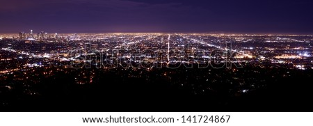 Los Angeles Metro Area Night Time Panorama. Los Angeles Downtown on the Left Side. American Cities Photo Collection. - stock photo