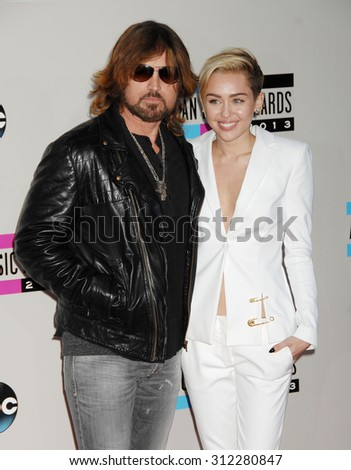 LOS ANGELES - NOV 24:  Billy Ray Cyrus and daughter Miley Cyrus arrives at the 2013 American Music Awards Arrivals  on November 24, 2013 in Los Angeles, CA                 - stock photo
