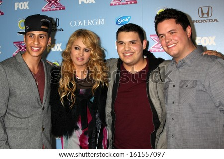 "LOS ANGELES - NOV 4:  Carlito Olivero, Paulina Rubio, Carlos Guevara, Tim Olstad at the 2013 ""X Factor"" Top 12 Party  at SLS Hotel on November 4, 2013 in Beverly Hills, CA - stock photo"