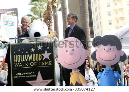 LOS ANGELES - NOV 2:  Craig Schultz, Leron Gubler, Snoopy at the Snoopy Hollywood Walk of Fame Ceremony at the Hollywood Walk of Fame on November 2, 2015 in Los Angeles, CA - stock photo