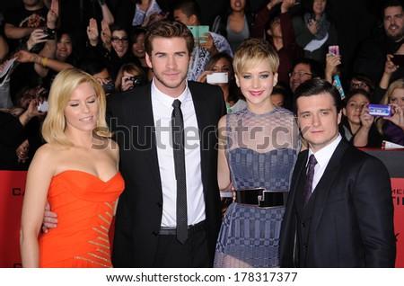 "LOS ANGELES - NOV 18:  Elizabeth Banks, Liam Hemsworth, Jennifer Lawrence & Josh Hutche arrives to ""The Hunger Games Catching Fire"" LA Premiere  on November 18, 2013 in Los Angeles, CA                 - stock photo"