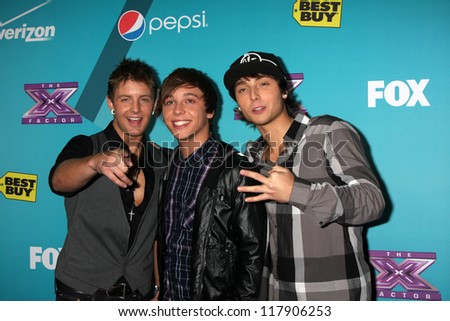 LOS ANGELES - NOV 5:  Emblem3 - Drew Chadwick, Keaton Stromberg, Wesley Stromberg arrives at the X-Factor Season Two FInalist Party at SLS Hotel at Beverly Hills on November 5, 2012 in Los Angeles, CA - stock photo