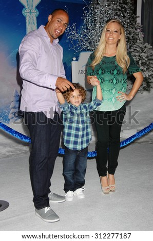 LOS ANGELES - NOV 19:  Hank Bassett, wife Kendra Wilkinson and family arrives at the Frozen World Premiere  on November 19, 2013 in Los Angeles, CA                 - stock photo