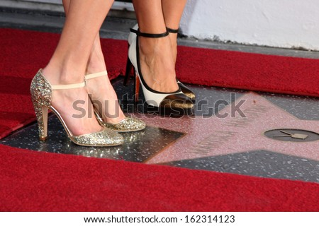 LOS ANGELES - NOV 8:  Hilary Swank, Mariska Hargitay at the Mariska Hargitay Hollywood Walk of Fame Star Ceremony at Hollywood Blvd on November 8, 2013 in Los Angeles, CA\ - stock photo