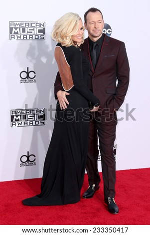 LOS ANGELES - NOV 23:  Jenny McCarthy, Donnie Wahlberg at the 2014 American Music Awards - Arrivals at the Nokia Theater on November 23, 2014 in Los Angeles, CA - stock photo