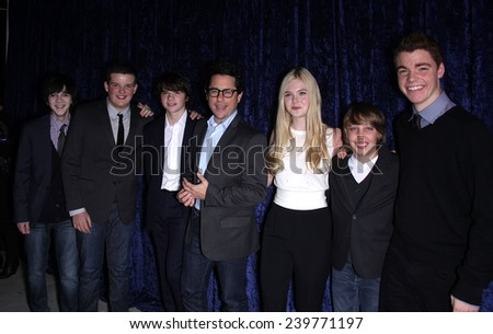 "LOS ANGELES - NOV 22:  JJ ABRAMS, ELLE FANNING & CAST arrives to the ""Super 8"" DVD Launch  on November 22, 2011 in Beverly Hills, CA                 - stock photo"