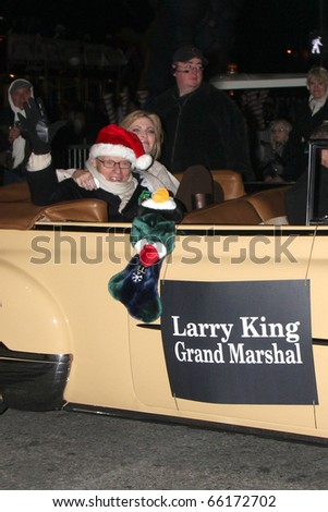 LOS ANGELES - NOV 28:  Larry King & Shawn Southwick King arrive at the 2010 Hollywood Christmas Parade at Hollywood Boulevard on November 28, 2010 in Los Angeles, CA - stock photo