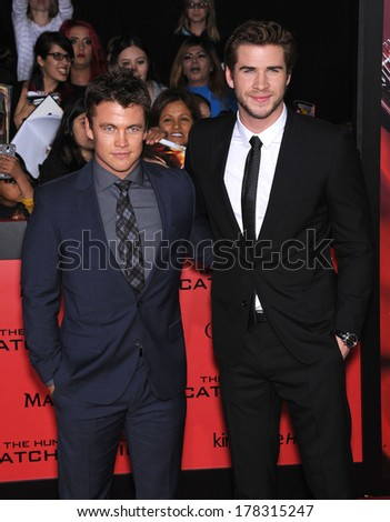 """LOS ANGELES - NOV 18:  Liam Hemsworth & Luke Hemsworth arrives to the """"The Hunger Games: Catching Fire"""" Los Angeles Premiere  on November 18, 2013 in Los Angeles, CA                 - stock photo"""