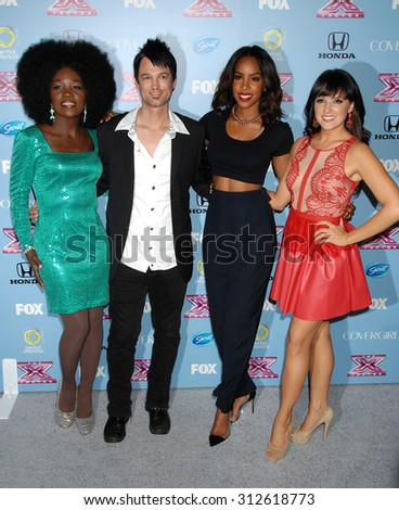 LOS ANGELES - NOV 4:  Lillie McCloud, Jeff Gutt, Kelly Rowland and Rachel Potter arrives at 2013 The X Factor Top 12 Finalists  Premiere  on November 4, 2013 in Beverly Hills, CA                 - stock photo