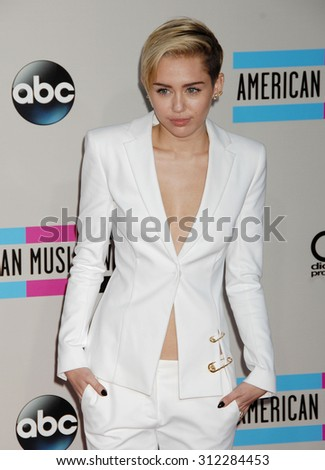 LOS ANGELES - NOV 24:  Miley Cyrus arrives at the 2013 American Music Awards Arrivals  on November 24, 2013 in Los Angeles, CA                 - stock photo