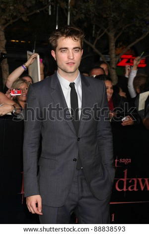 """LOS ANGELES - NOV 14:  Robert Pattinson arrives at the """"Twilight: Breaking Dawn Part 1"""" World Premiere at Nokia Theater at LA LIve on November 14, 2011 in Los Angeles, CA - stock photo"""