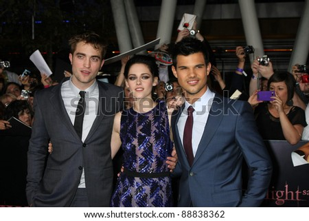 "LOS ANGELES-NOV 14:  Robert Pattinson, Kristen Stewart, Taylor Lautner arrive at the ""Twilight: Breaking Dawn Part 1"" World Premiere at Nokia Theater at LA LIve on November 14, 2011 in Los Angeles, CA - stock photo"