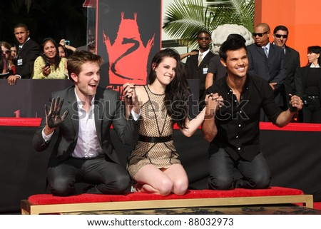 LOS ANGELES - NOV 3:  Robert Pattinson, Taylor Lautner, Kristen Stewart at their Handprint and Footprint Ceremony at Grauman's Chinese Theater on November 3, 2011 in Los Angeles, CA - stock photo