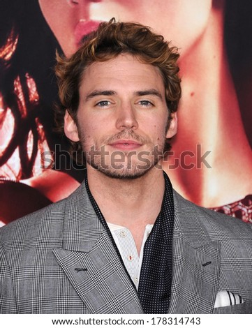 """LOS ANGELES - NOV 18:  Sam Claflin arrives to the """"The Hunger Games: Catching Fire"""" Los Angeles Premiere  on November 18, 2013 in Los Angeles, CA                 - stock photo"""