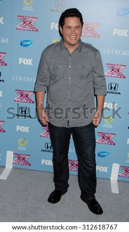 LOS ANGELES - NOV 4:  Tim Olstad arrives at 2013 The X Factor Top 12 Finalists  Premiere  on November 4, 2013 in Beverly Hills, CA                 - stock photo
