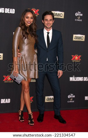 "LOS ANGELES - OCT 2:  Amber Stevens, Andrew J. West at the ""The Walking Dead"" Season 5 Premiere at Universal City Walk on October 2, 2014 in Los Angeles, CA - stock photo"