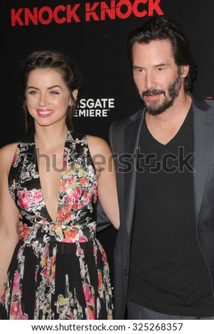 """LOS ANGELES - OCT 7:  Ana de Armas, Keanu Reeves at the """"Knock Knock"""" Los Angeles Premiere at the TCL Chinese 6 Theaters on October 7, 2015 in Los Angeles, CA - stock photo"""